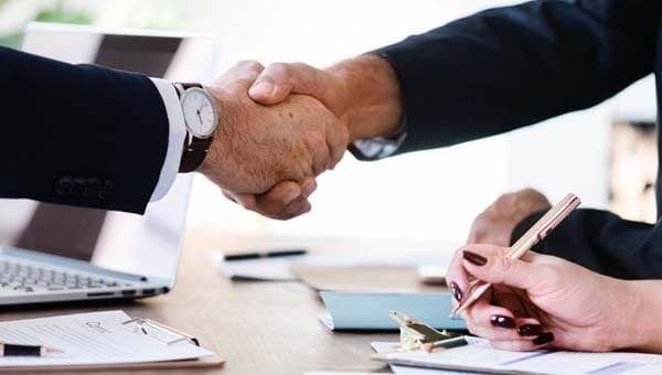 accountant shaking hands
